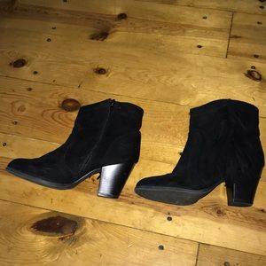 Cute black booties with fringe.